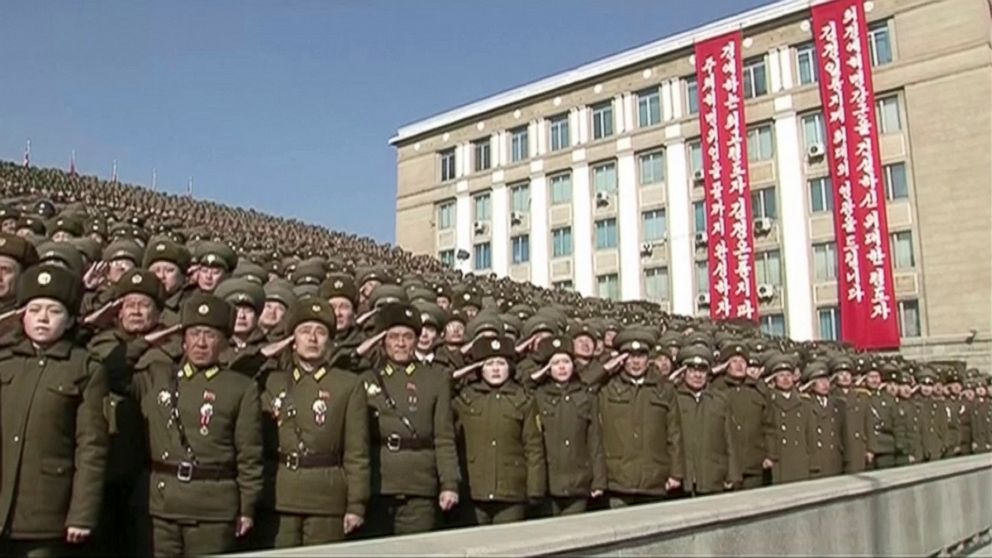 In this image made from video by North Korea's KRT, North Korean troops salute during a parade in Pyongyang, North Korea, Feb. 8, 2018.