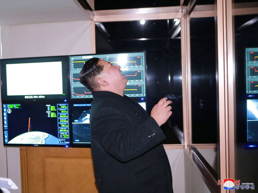 PHOTO: North Koreas leader Kim Jong Un is seen peering through a window in a photo released by North Koreas Korean Central News Agency on Nov. 30, 2017 after the successful test launch of a Hwasong-15 intercontinental ballistic rocket.