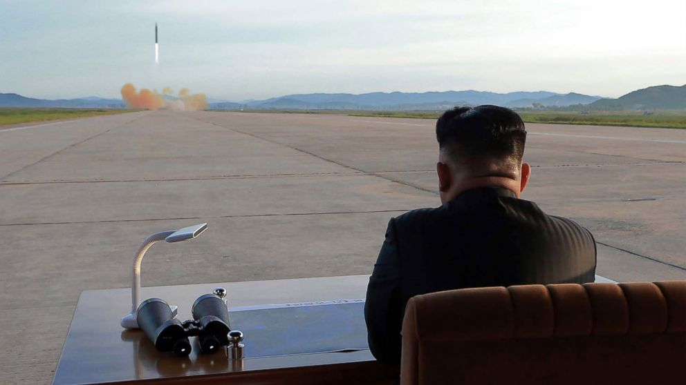 North Korean leader Kim Jong Un watches a launching drill of the medium-and-long range strategic ballistic rocket Hwasong-12 at an undisclosed location, in a photo released on Sept. 16, 2017 by the Korean Central News Agency.