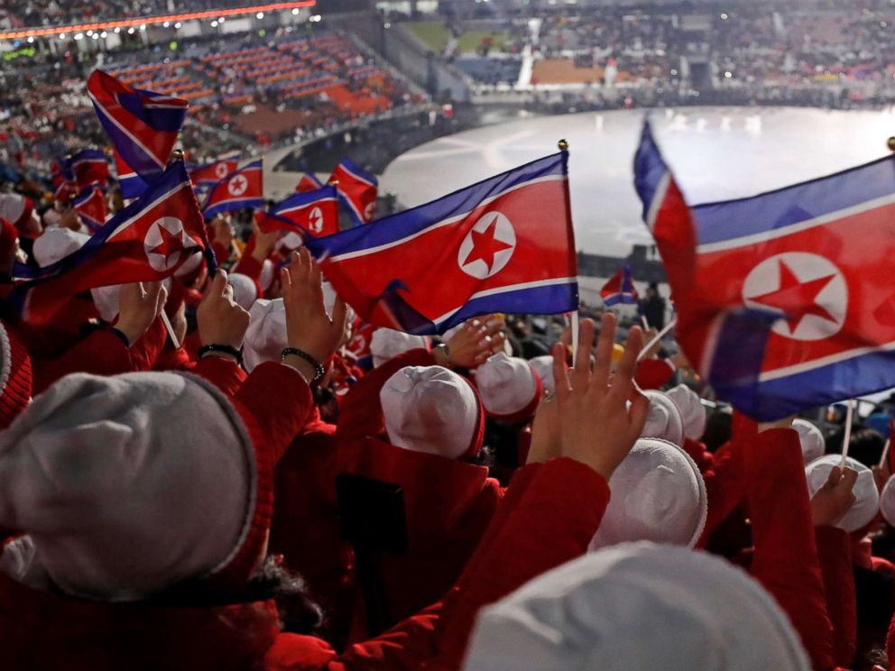PHOTO: Members of the North Korean cheerleading team wave flags before the start of the Opening Ceremony of the Pyeongchang 2018 Winter Olympics, Feb. 9, 2018.