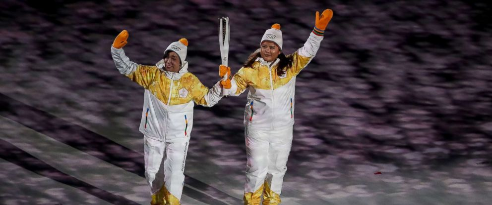 PHOTO: Unified Koreas torchbearers, North Koreas Jong Su Hyon and South Koreas Park Jong-ah, hold the Olympic torch during the opening ceremony of the Pyeongchang 2018 Winter Olympic Games, Feb. 9, 2018.