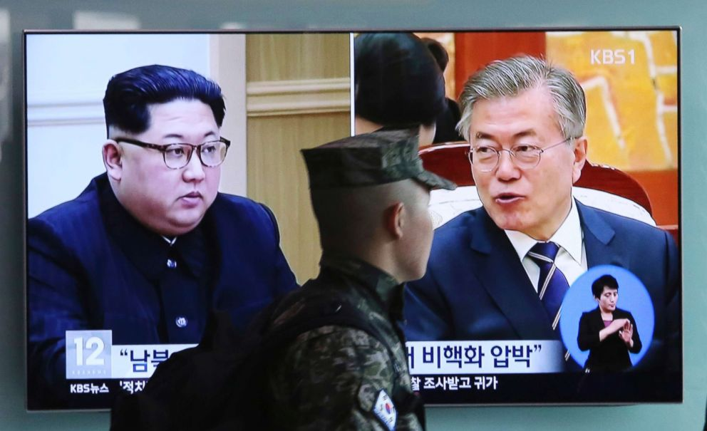 PHOTO: A South Korean marine soldier passes by a TV screen showing file footage of South Korean President Moon Jae-in and North Korean leader Kim Jong Un, left, during a news program at the Seoul Railway Station in Seoul, South Korea, April 18, 2018.
