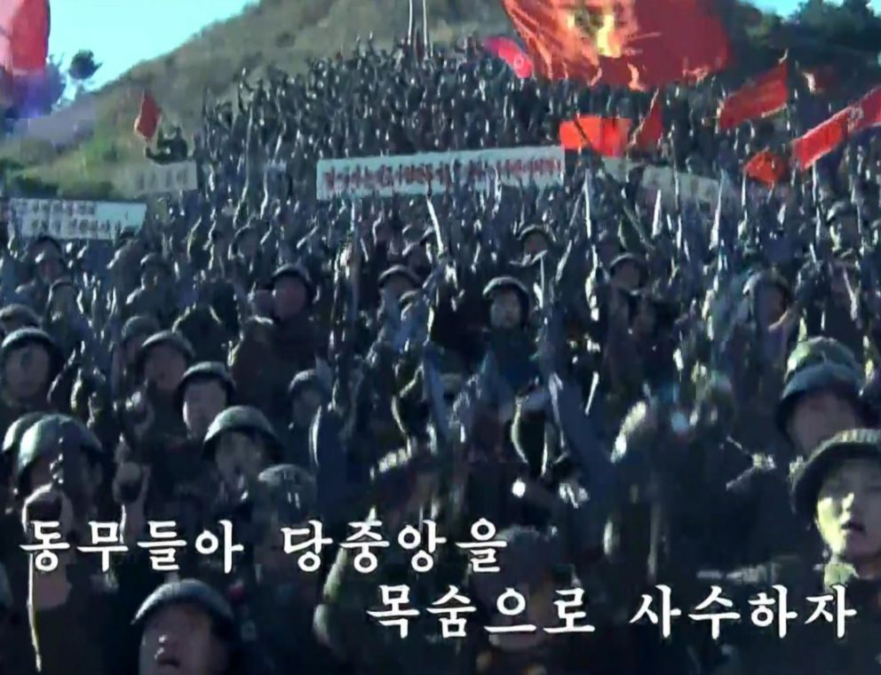 PHOTO: Subtitles help viewers sing along to propaganda songs on Korean Central Television. Comrades, risk your lives to guard the Central Party, one song implored last week.