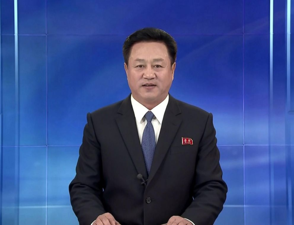 PHOTO: An anchorperson on Korean Central Television wears a Western suit and speaks in a confident tone.