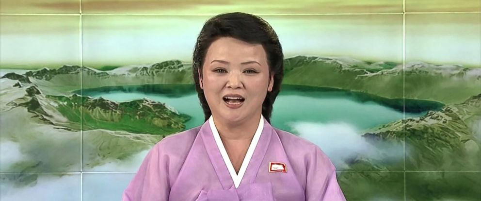 "PHOTO: An anchorperson wears a traditional Korean dress called a ""hanbok."" News reports begin with a bow."