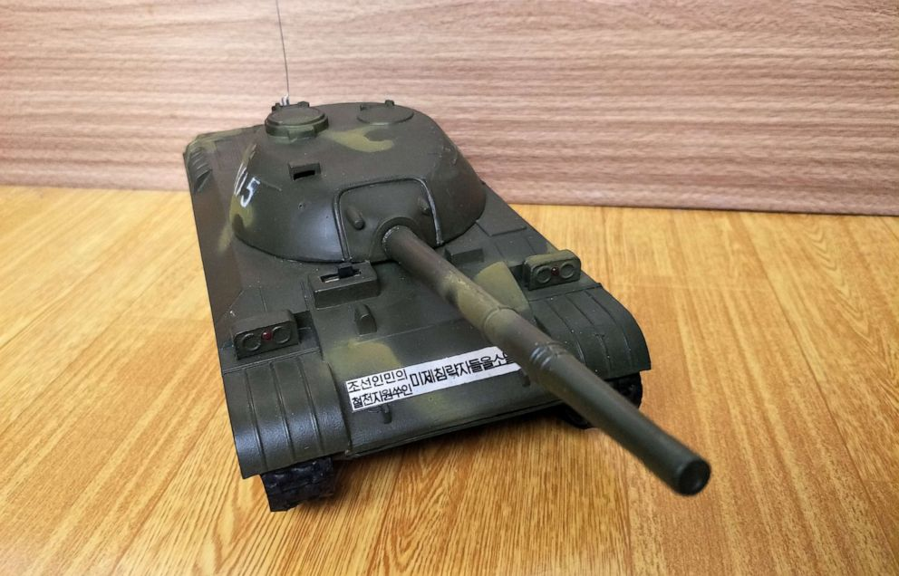 PHOTO: A toy tank with a slogan that reads, Annihilate the American Imperialists, purchased in Pyongyang, North Korea.