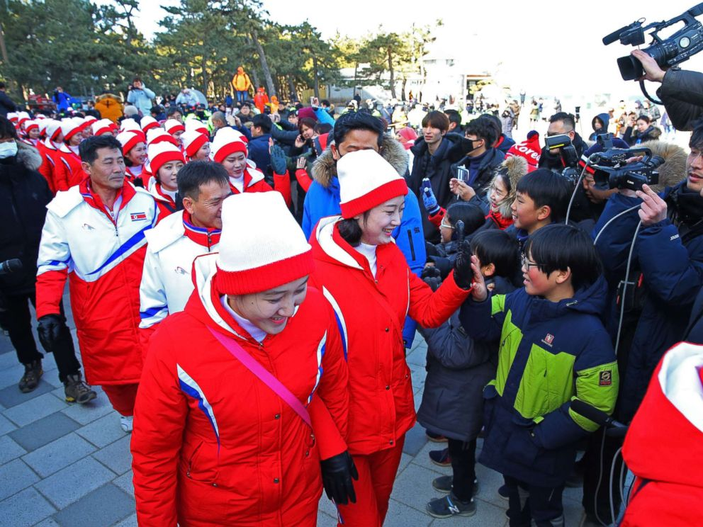 PHOTO: A group of North Korean cheerleaders for the Pyeongchang Winter Olympics greets South Koreans as they visit Gyeongpo Beach in Gangneung, South Korea, Feb. 13, 2018.