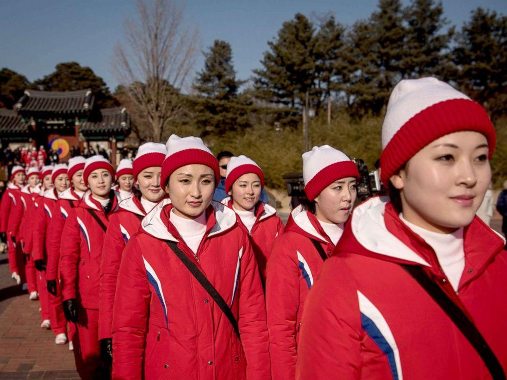PHOTO: North Korean cheerleaders walk through Ojukheon House, one of the oldest traditional Korean houses in South Korea, in Gangneung, Feb. 13, 2018.