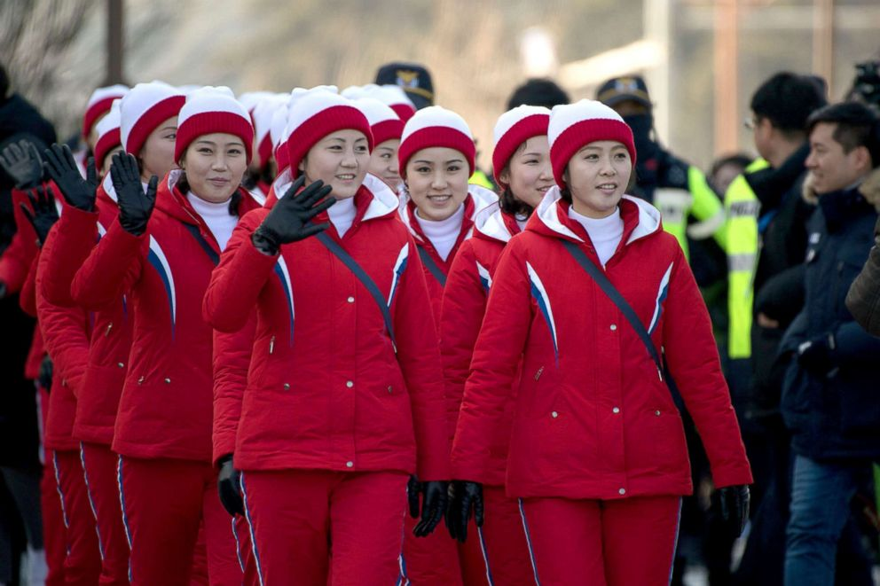 PHOTO: North Korean cheerleaders walk towards Gyeongpo beach in Gangneung, South Korea, Feb. 13, 2018.