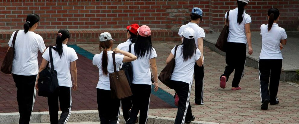 PHOTO: Women who defected from North Korea walk for their class at the Hanawon, a state-run official shelter for North Korean defectors, in Ansung, South Korea, July 28, 2009.