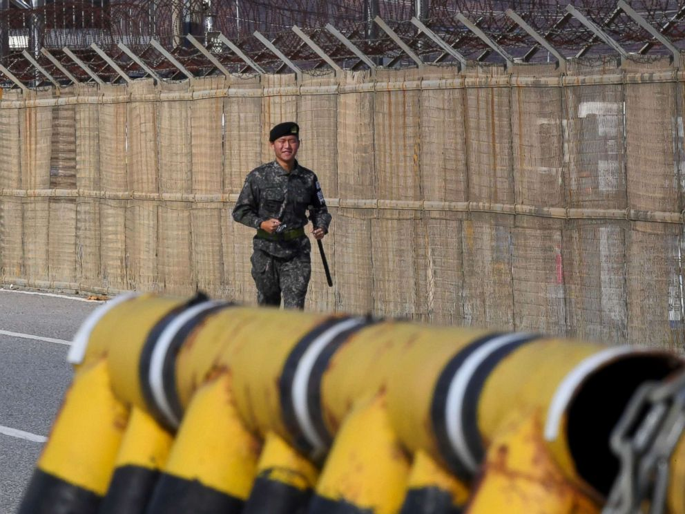 PHOTO: A South Korean soldier runs along a military fence on the road leading to the truce village of Panmunjom at a South Korean military checkpoint in the border city of Paju near the Demilitarized Zone (DMZ) dividing the two Koreas, Nov. 14, 2017.