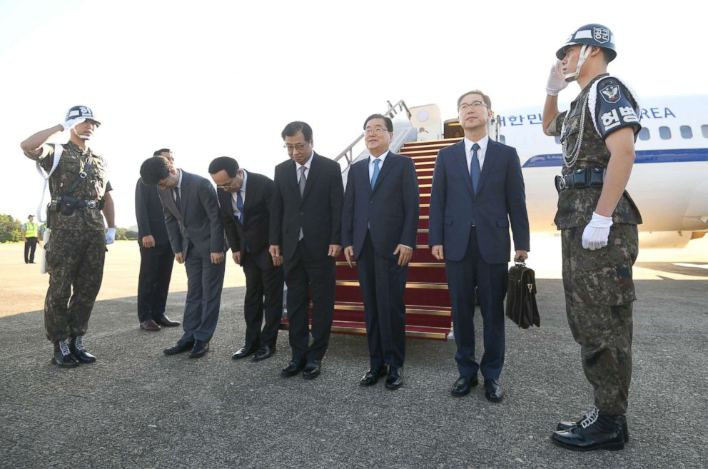 PHOTO: Chung Eui-yong (3rd R), head of the presidential National Security Office, and other delegaters pose before boarding an aircraft as they leave for Pyongyang at a military airport, Sept. 5, 2018, in Seounfnam, South Korea.