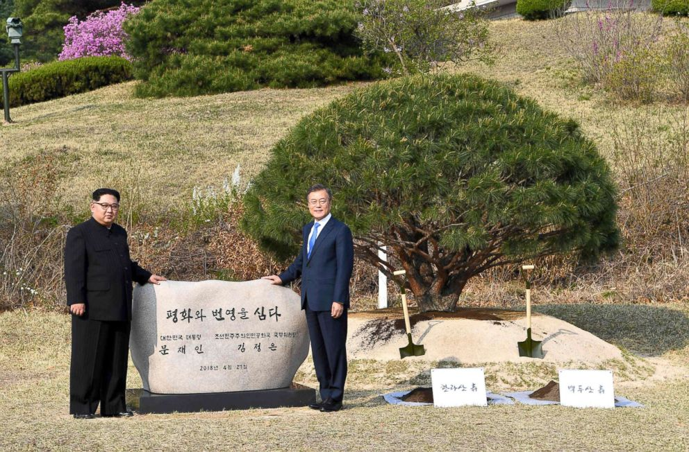 PHOTO: Kim Jong Un and Moon Jae-in participate in a tree-planting ceremony next to the Military Demarcation Line that forms the border between the two Koreas at the truce village of Panmunjom, April 27, 2018.