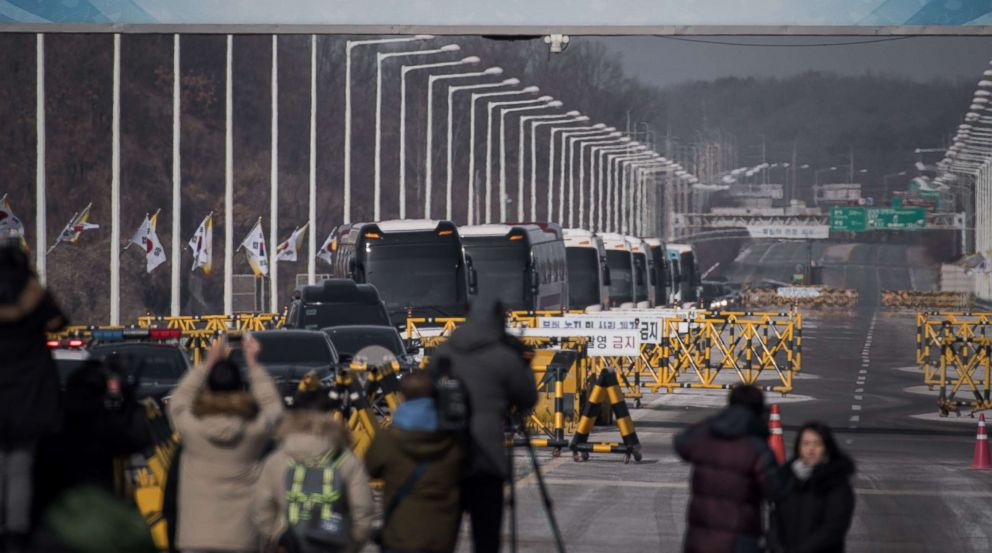 PHOTO: Busses carrying a 280-member delegation of North Korean cheerleaders crosses a checkpoint on Tongil bridge after arriving in South Korea, in Paju on February 7, 2018.