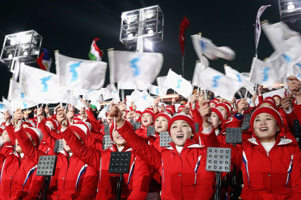 PHOTO: Members of the North Korean cheerleader squad sing and wave flags prior to the Opening Ceremony of the 2018 Winter Olympic Games in Pyeongchang, South Korea, Feb. 9, 2018.
