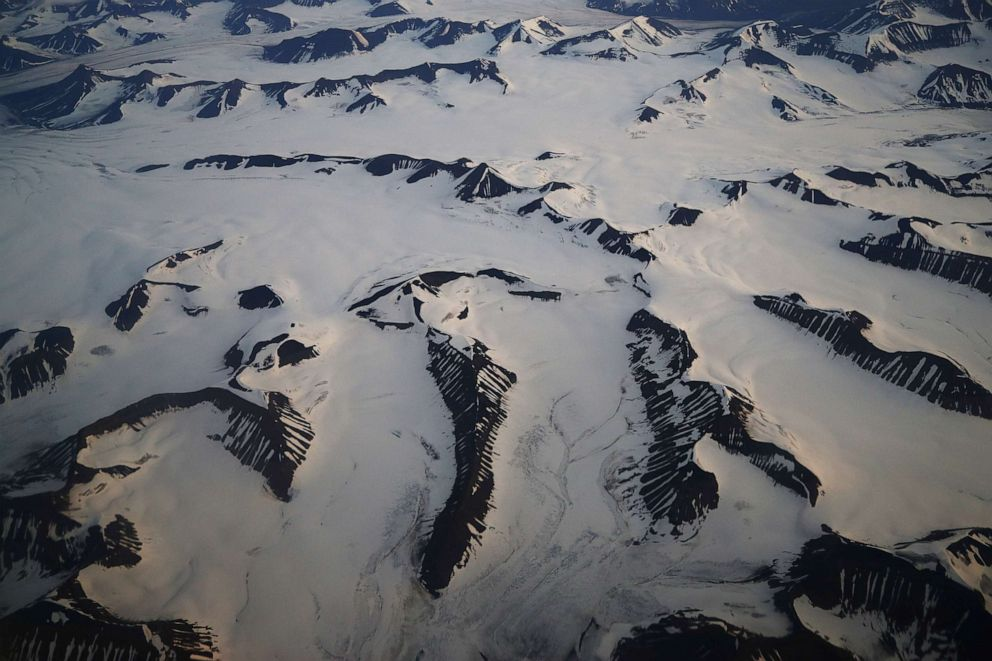 PHOTO: An aerial view shows snow-covered mountains in Svalbard, Norway, Aug. 3, 2019.