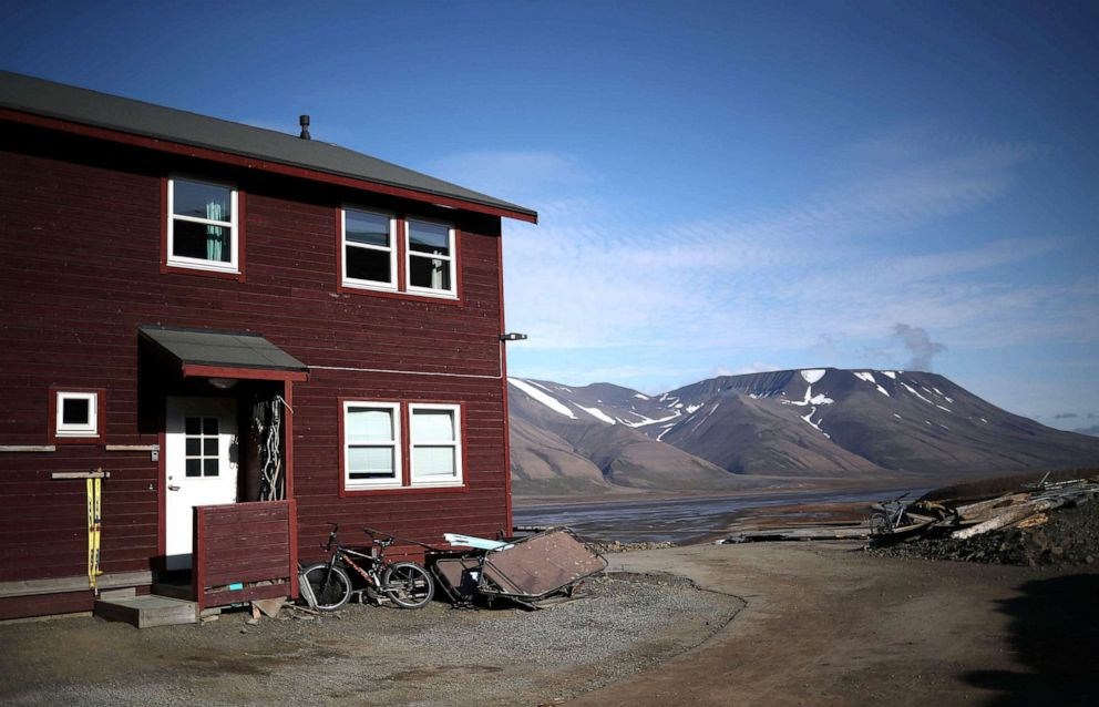 PHOTO: A residential house is seen in front of snow capped mountains in the town of Longyearbyen in Svalbard, Norway, Aug. 4, 2019.