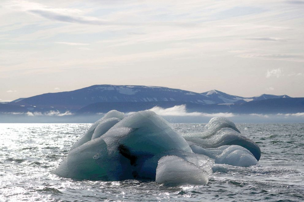 PHOTO: An iceberg floats near the Wahlenberg Glacier in Oscar II land at Spitsbergen in Svalbard, Norway, Aug. 5, 2019.