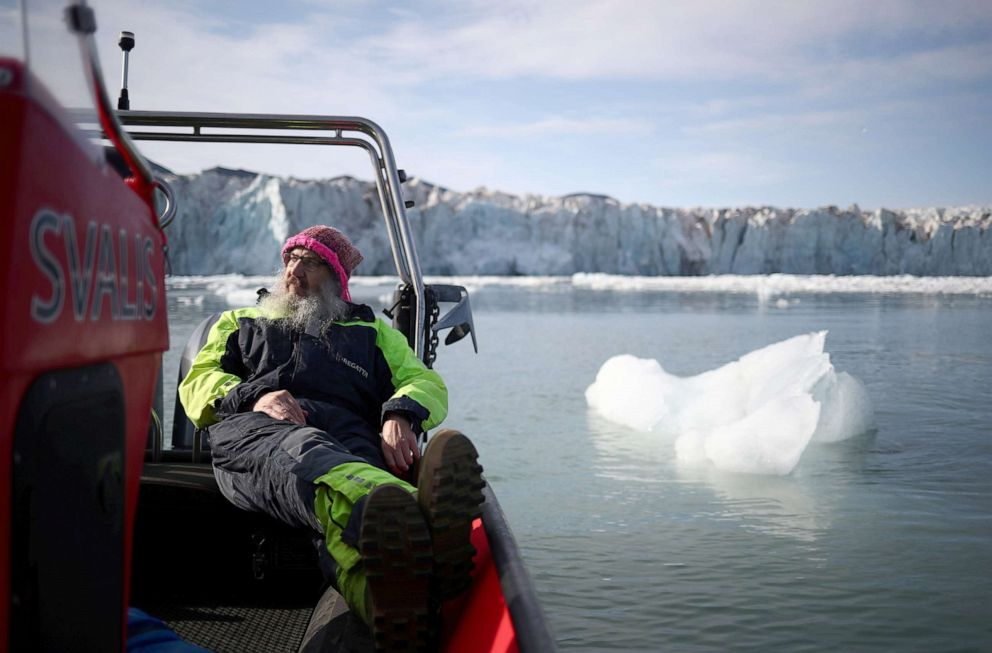 PHOTO:International director of the Norwegian Polar Institute, Kim Holmen, relaxes with a cup of tea as he travels past the Wahlenberg Glacier in Oscar II land at Spitsbergen in Svalbard, Norway, Aug. 5, 2019.