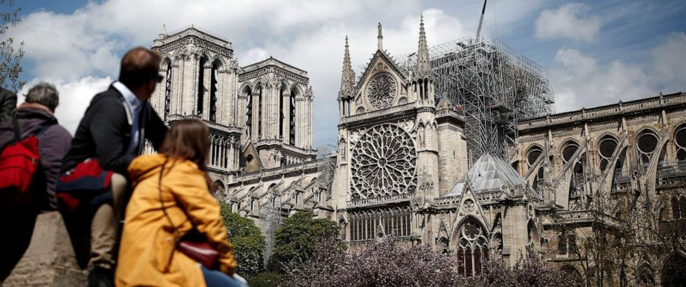 PHOTO: People look at Notre-Dame Cathedral two days after a massive fire devastated large parts of the gothic structure in Paris, France, April 17, 2019.