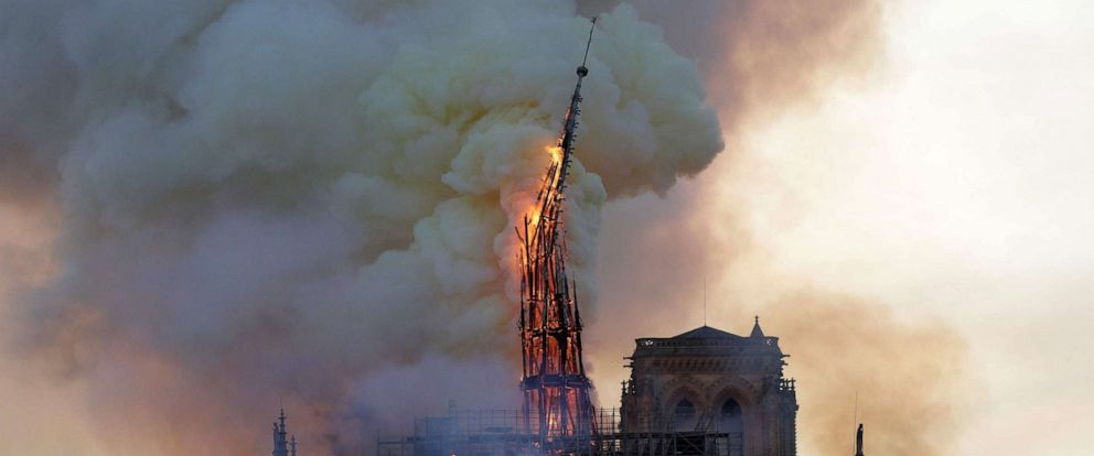 PHOTO: The steeple of the landmark Notre-Dame Cathedral collapses as the cathedral is engulfed in flames in Paris, April 15, 2019.