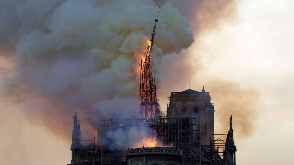 The steeple of the landmark Notre-Dame Cathedral collapses as the cathedral is engulfed in flames in Paris, April 15, 2019.