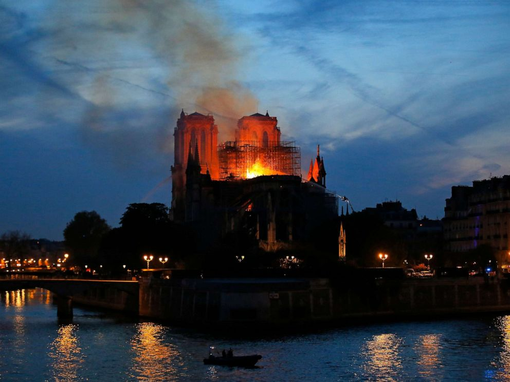 PHOTO: Firefighters tackle the blaze as flames rise from Notre Dame cathedral as it burns in Paris, April 15, 2019.