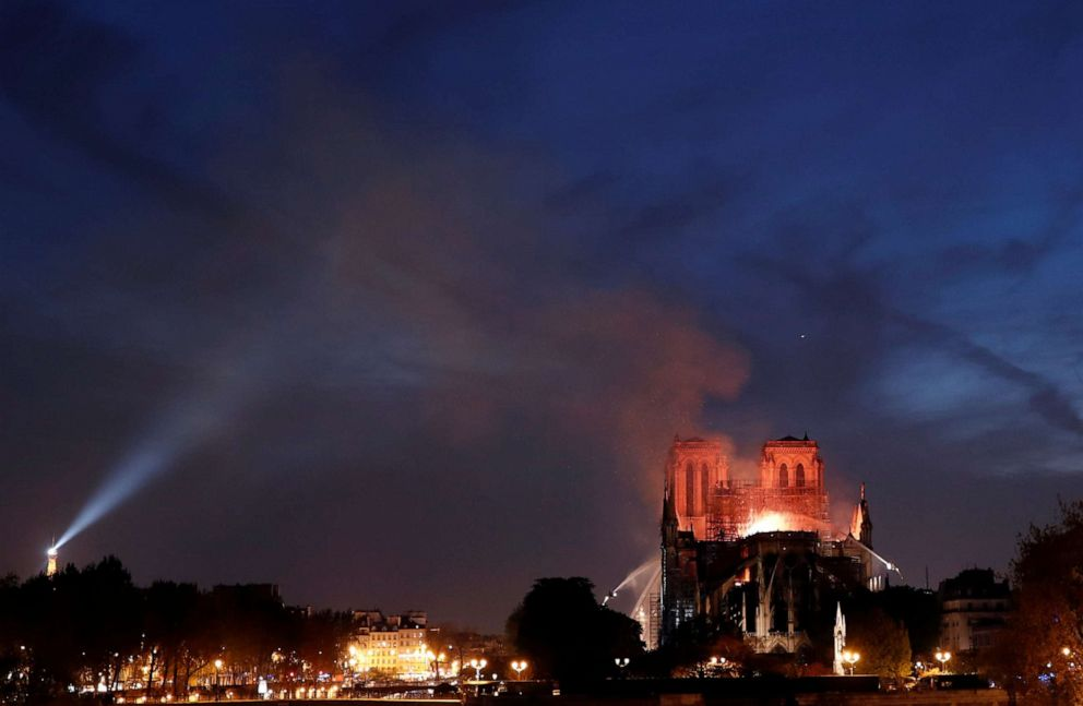 PHOTO: Fire fighters douse flames of the burning Notre Dame Cathedral in Paris, April 15, 2019.