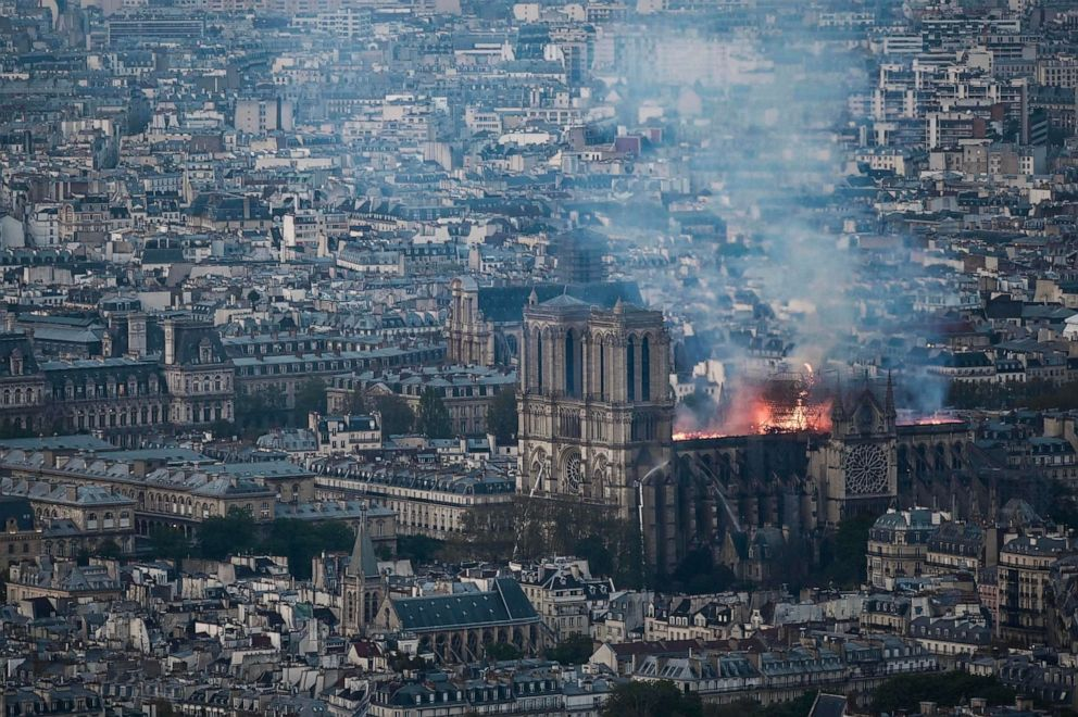 Smoke and flames rise during a fire at Notre-Dame Cathedral in Paris, April 15, 2019.