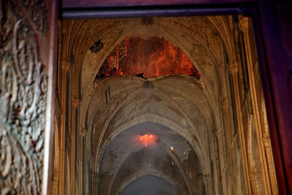 PHOTO: Flames and smoke are seen as the interior continues to burn inside the Notre Dame Cathedral in Paris, April 16, 2019.