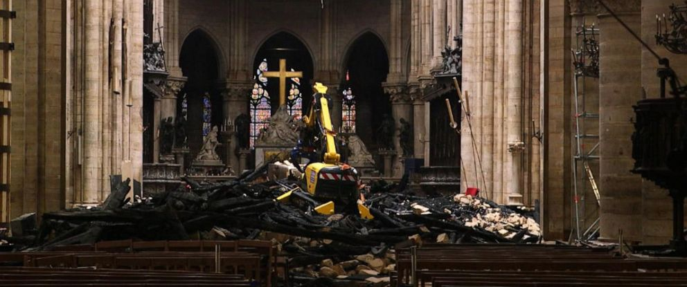 PHOTO: Debris litters the nave of Paris Notre Dame cathedral nearly a month after the devastating fire damaged a large section of roof in April 2019.