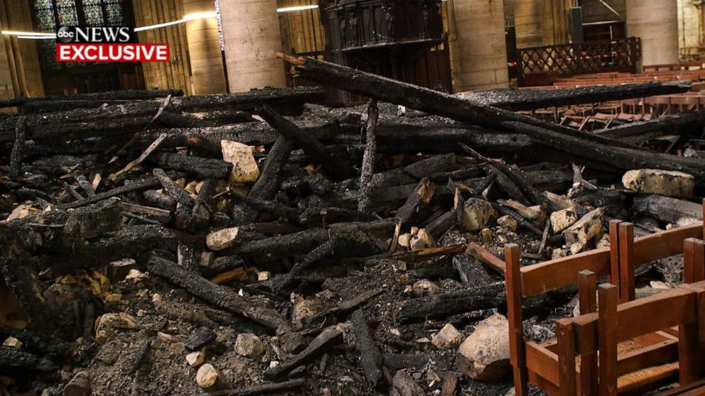 PHOTO: Remains of the spire of Notre Dame cathedral in Paris collapsed into the buildings nave during a fire that destroyed much of the roof in April 2019.
