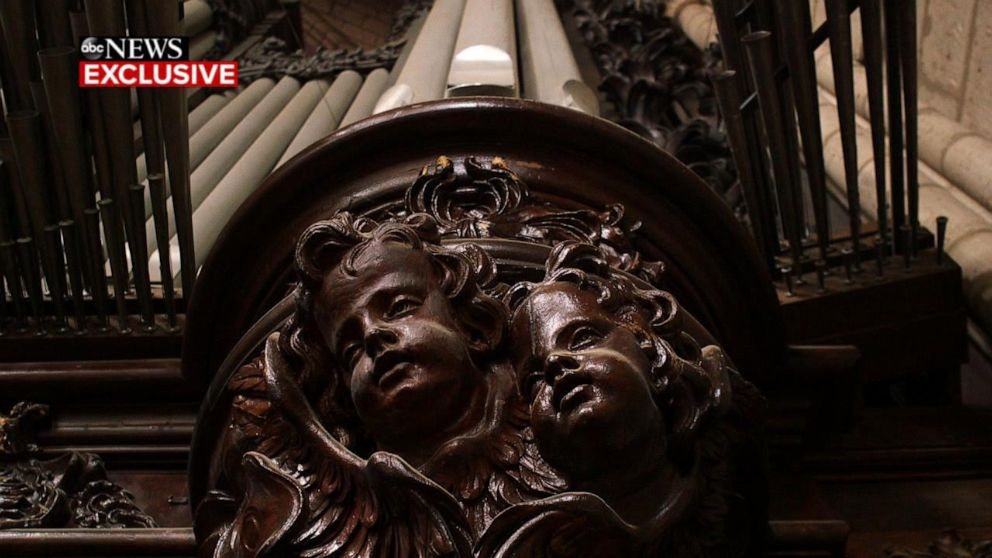 PHOTO: Carved cherubs decorate the pipe organ that survived the fire in Paris Notre Dame cathedral.