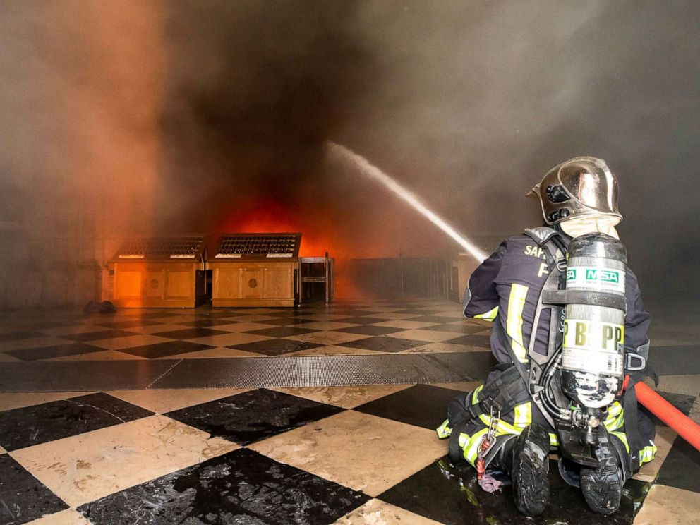 PHOTO: This photo provided Tuesday April 16, 2019 by the Paris Fire Brigade shows fire fighters spraying water inside Notre Dame cathedral, Monday April 15, 2019.
