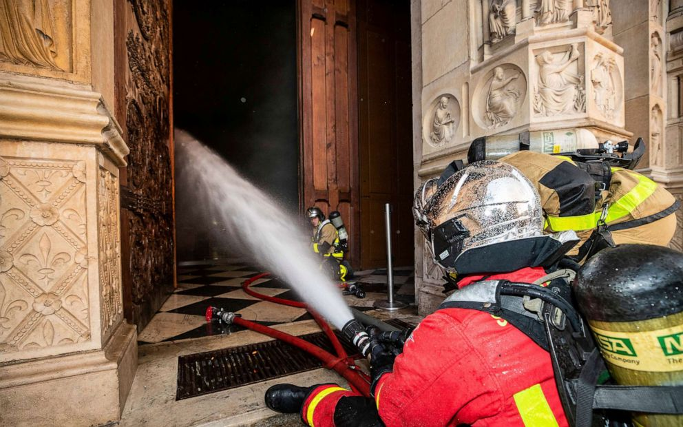 PHOTO: Fire fighters spray water inside Notre Dame cathedral, April 15, 2019.