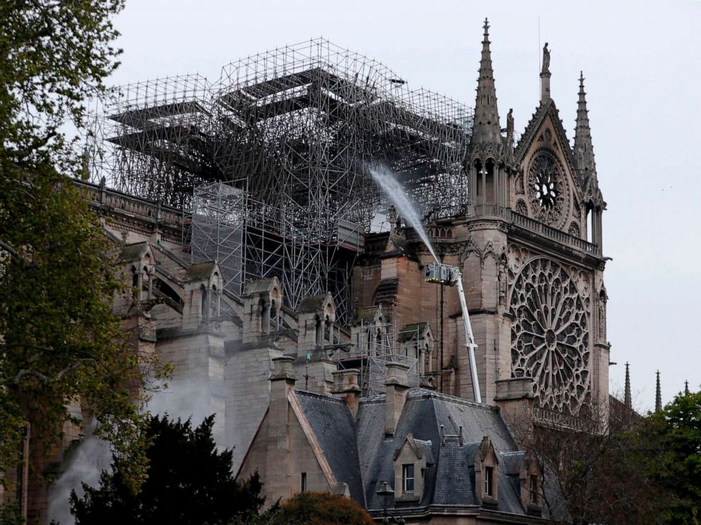 PHOTO:Firefighters spray water as they work to extinguish a fire at Notre-Dame Cathedral in Paris early on April 16, 2019.