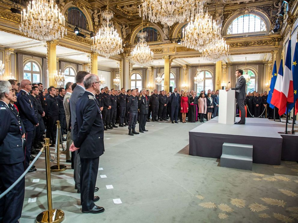 PHOTO: French President Emmanuel Macron delivers a speech for the Parisian Firefighters brigade and security forces who took part at the fire extinguishing operations during the Notre Dame Cathedral fire, at Elysee Palace in Paris, April 18, 2019.