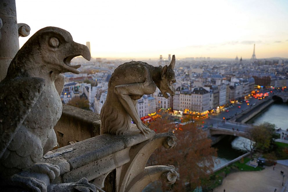 Gargoyles perch on the Notre Dame Cathedral overlooking the Seine in Paris, Dec. 20, 2015.