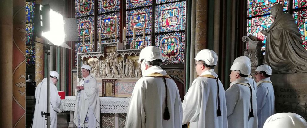 PHOTO: The Archbishop of Paris Michel Aupetit leads the first mass in a side chapel two months to the day after a devastating fire engulfed the Notre-Dame de Paris cathedral, in Paris, June 15, 2019.