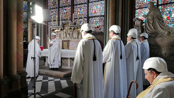 Notre Dame Cathedral holds first mass since devastating fire, with attendees in hardhats
