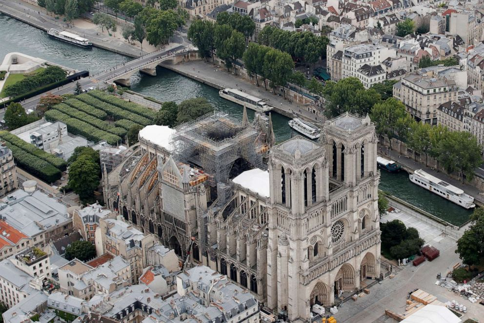 PHOTO: A view shows the damaged roof of Notre-Dame de Paris during restoration work, three months after a fire that devastated the cathedral in Paris, July 14, 2019.