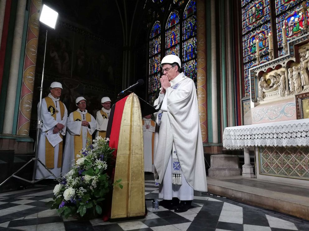 PHOTO:Clerics attend a mass led by Michel Aupetit Archbishop of Paris, which is the first church service in a side chapel of Notre-Dame de Paris cathedral in Paris, June 15, 2019, two months to the day after a devastating fire.