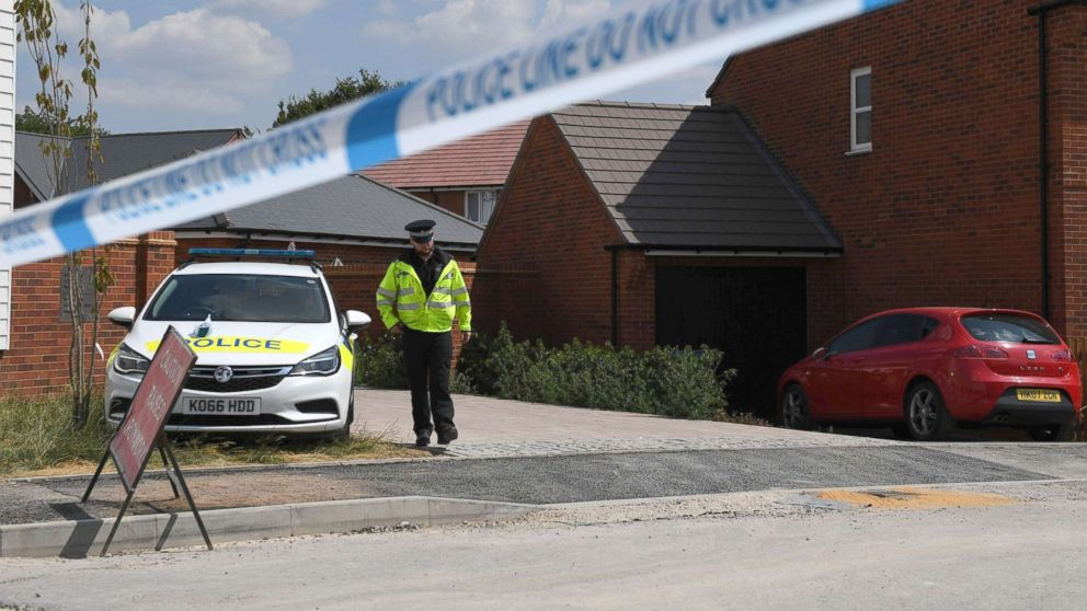 A police officer guards a cordon at a residential address in Amesbury, southern England, July 5, 2018, where police reported a man and woman were found unconscious in circumstances that sparked a major incident after contact with what was later identified as the nerve agent Novichok.