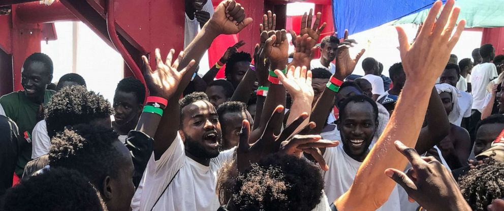 PHOTO: Migrants celebrate aboard the Ocean Viking rescue ship, on August 23, 2019, as six EU countries agreed to take them in after 14 days at sea.