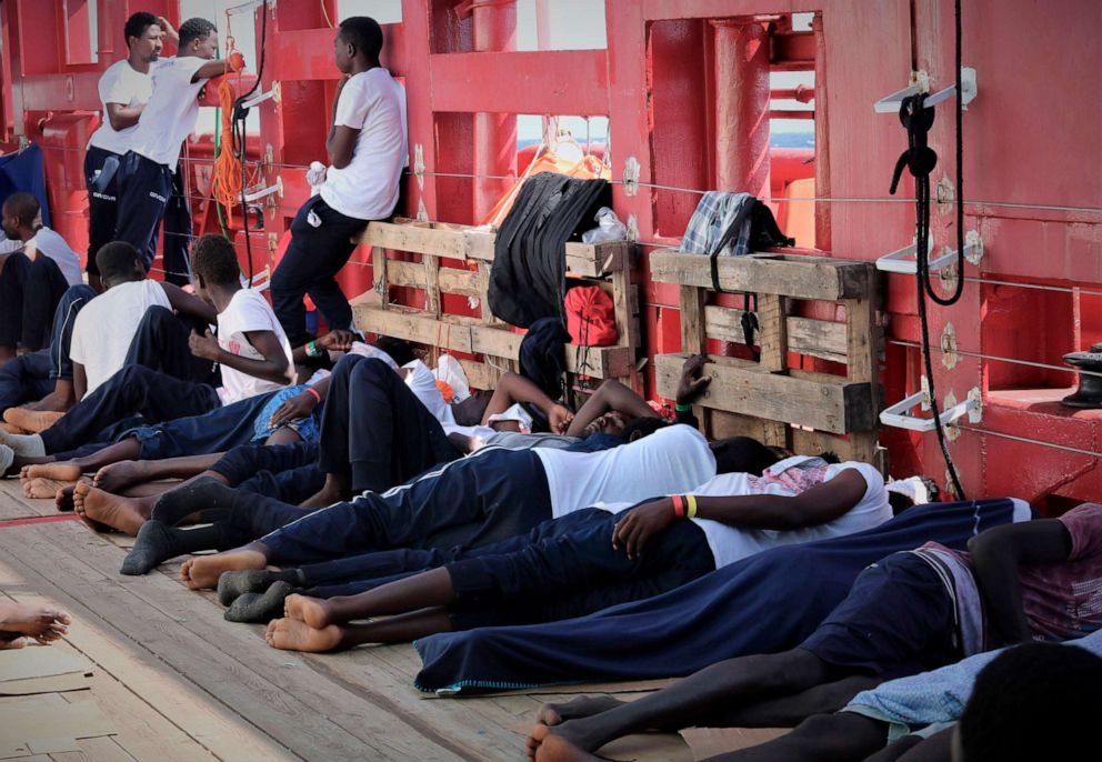 PHOTO:In this Aug. 13, 2019 photo made available Monday, Aug. 19, 2019, rescued migrants rest on the deck of the Norwegian-flagged Ocean Viking vessel.