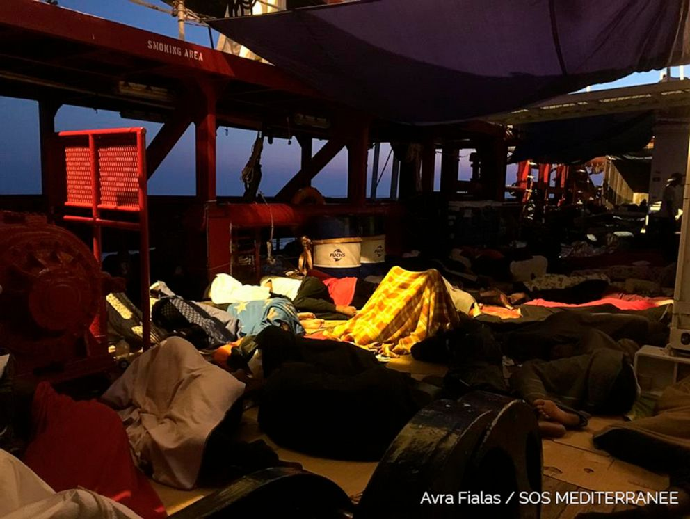 PHOTO: Rescued migrants sleep on the Ocean Viking, operated by SOS Mediterranee and MSF, as they cruise in the Mediterranean Sea, in the early hours of Friday, Aug. 23, 2019.