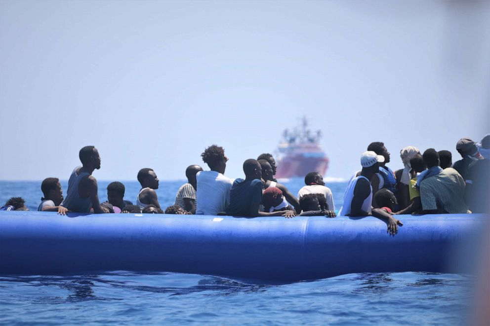 PHOTO: A handout photo dated 12 August 2019 and made available by Doctors Without Borders (MSF) on 19 August 2019, showing migrants on a rubber dinghy waiting for their rescue by the rescue vessel Ocean Viking off the coast of Libya in the Mediterranean.