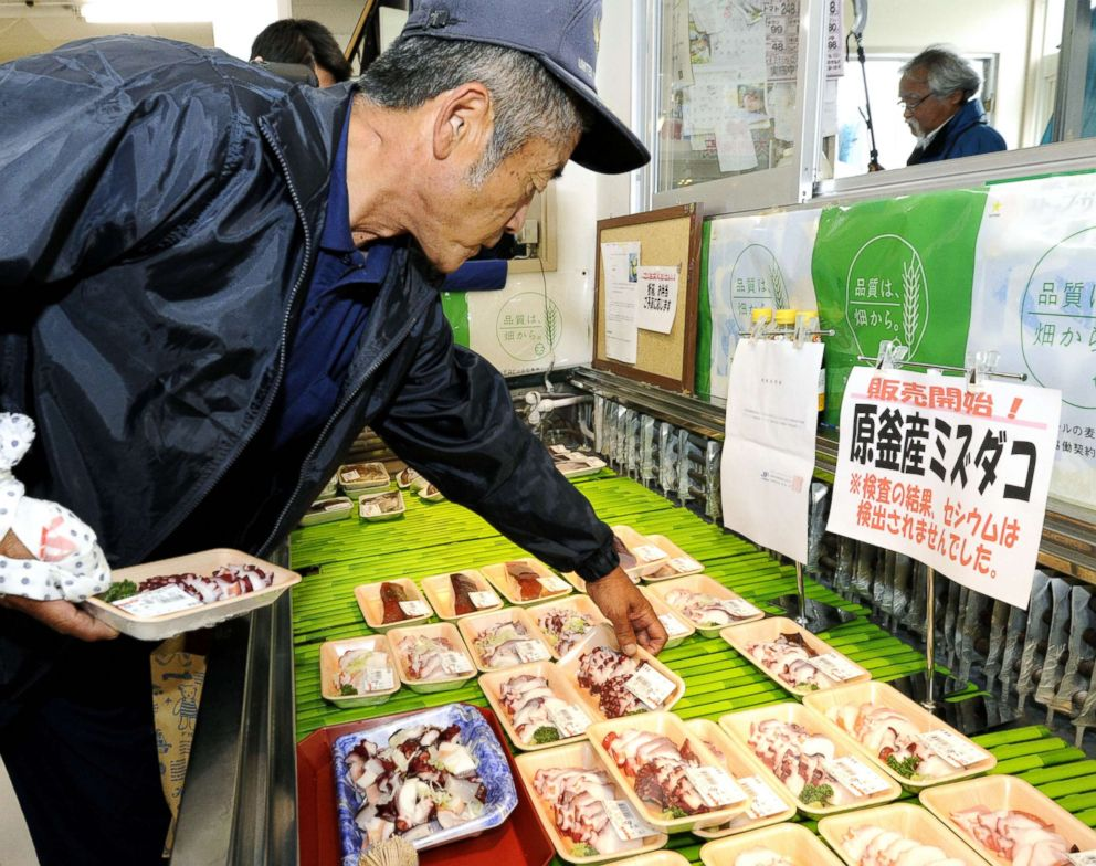 PHOTO: A man picks up a pack of octopus at a supermarket in Soma, Fukushima Prefecture, on June 25, 2012.