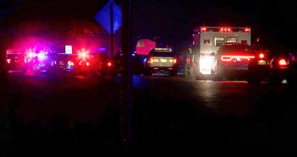 In this image made from a video provided by FOX19Now.com lights illuminate police vehicles as authorities respond to a standoff at an apartment complex in Ohio, about 20 miles east of Cincinnati, Feb. 3, 2019.