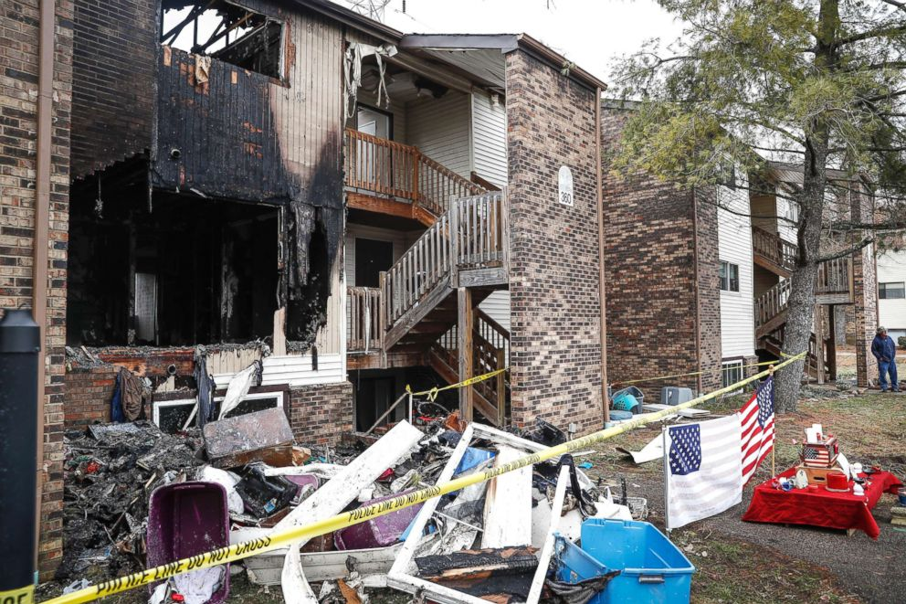 PHOTO: Police tape surrounds an apartment damaged by fire involved in a shooting incident that resulted in the death of a Clermont County Sheriffs Office Deputy, Feb. 4, 2019, in Pierce Township, Ohio.